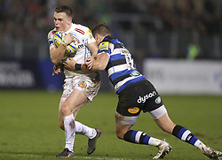 Exeter's Joe Simmonds is tackled by Bath's James Wilson during the Aviva Premiership match at the Recreation Ground, Bath.