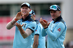 England's Ben Stokes and Jason Roy applauds the crowd after Chris Woakes takes the catch to dismiss Pakistan's Imam-ul-Haq during the ICC Cricket World Cup group stage match at Trent Bridge, Nottingham.