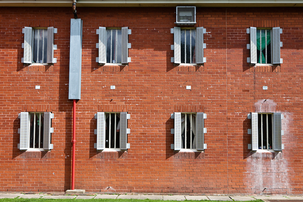 Barred cell windows on one of the residential wings. HMP The Mount, Bovingdon, Hertfordshire