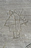 Petroglyph, rock carving, depicting high house built on poles . Carved by the ancient Camunni people in the iron age between 1000-1600 BC. Rock no 24,  Foppi di Nadro, Riserva Naturale Incisioni Rupestri di Ceto, Cimbergo e Paspardo, Capo di Ponti, Valcamonica (Val Camonica), Lombardy plain, Italy .<br /> <br /> Visit our PREHISTORY PHOTO COLLECTIONS for more   photos  to download or buy as prints https://funkystock.photoshelter.com/gallery-collection/Prehistoric-Neolithic-Sites-Art-Artefacts-Pictures-Photos/C0000tfxw63zrUT4<br /> If you prefer to buy from our ALAMY PHOTO LIBRARY  Collection visit : https://www.alamy.com/portfolio/paul-williams-funkystock/valcamonica-rock-art.html