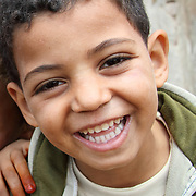 A young boy grins for the camera. Dahab Island, Cairo.