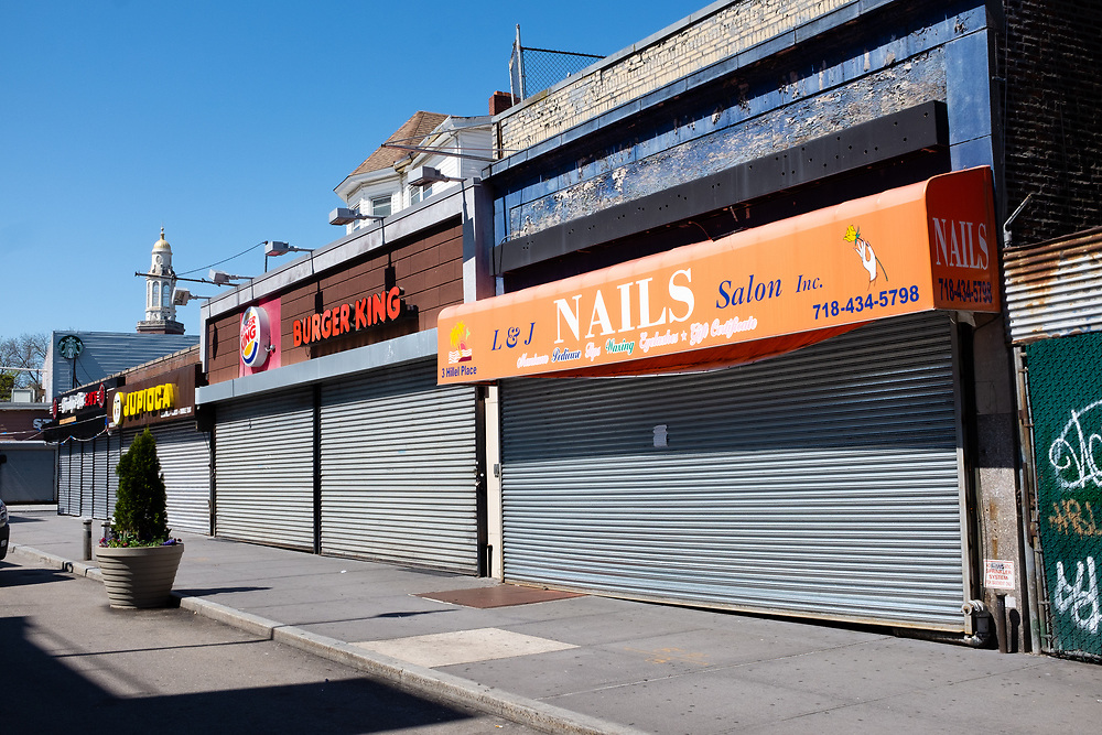 Brooklyn, NY - 15 April 2020. Four shops and restaurants on Hillel Place near Brooklyn College are shuttered. Stores and restaurants near Brooklyn College in Brooklyn's Midwood Neighborhood close in response to orders for non-essential businesses to close. Some food businesses tried to remain open for takeout, but could not afford to, especially after the college closed.