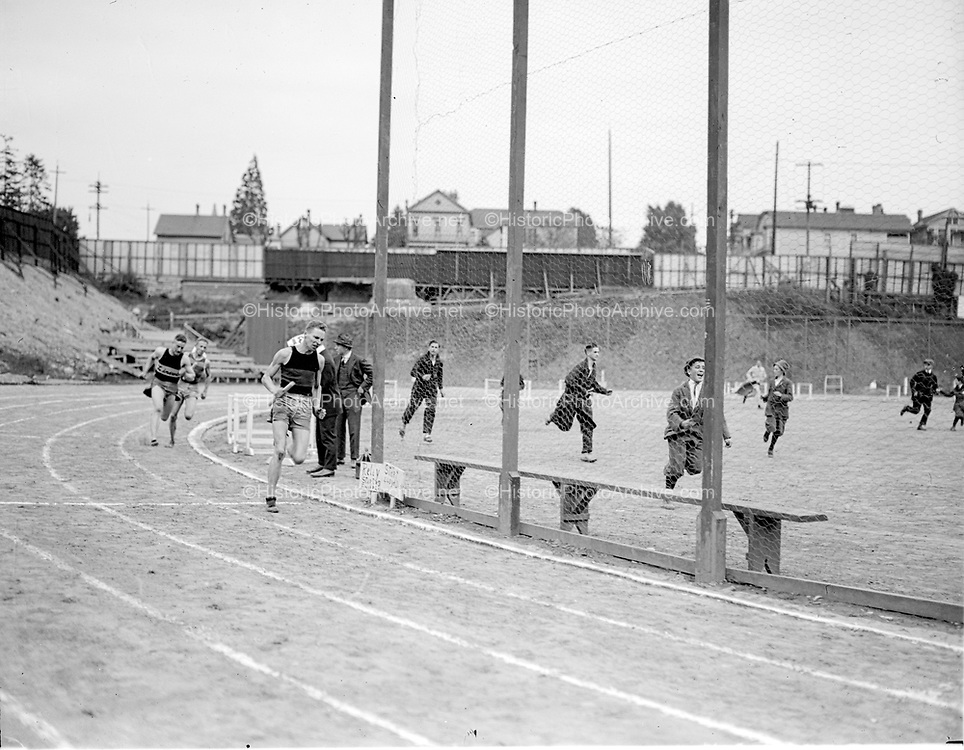 """Finish relay Johnson W. H. S. lead"" (Multnomah Field. Note 19th Avenue buildings in background)"