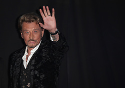 File photo : ABACAPRESS.COM - Johnny Hallyday arriving at the Virgin store at Midnight on Champs Elysees to the launching of his new album CD.