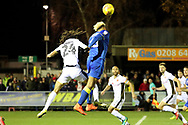 AFC Wimbledon striker Lyle Taylor (33) battles for possession with Walsall defender Kory Roberts (24) during the EFL Sky Bet League 1 match between AFC Wimbledon and Walsall at the Cherry Red Records Stadium, Kingston, England on 25 November 2017. Photo by Matthew Redman.