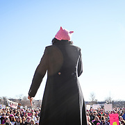 a speaker addresses the crowd gathered at First Ward Park in uptown Charlotte for the 2018 Women's March.