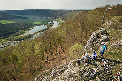 Young men sitting and looking at view, Bavaria, Germany