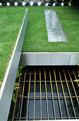 Stainless steel trays of lawn on different levels. Steel rill dropping down to square ponds below.  Design Diarmuid Gavin