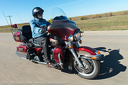Marine Veteran Phil Bechtold with the Sioux Falls HOG chapter on his 2009 FLHTCUI for the USS South Dakota submarine flag relay across South Dakota on the first day from Sturgis to Aberdeen. SD. USA. Saturday October 7, 2017. Photography ©2017 Michael Lichter.