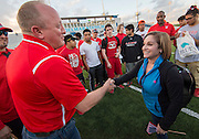 Waltrip principal Edward Mitchell greets former US Olympic gymnast Mary Lou Retton before the Wounded Warrior Amputee Football Team game against NFL Alumni, at Delmar Stadium, February 1, 2017.