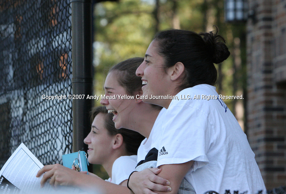 04 November 2007: Duke women's players (from right) Alison Lipsher, Madeline McEwen, and Lorraine Quinn watch the game. The Alabama A&M University Bulldogs defeated the Duke University Blue Devils 4-3 at Koskinen Stadium in Durham, North Carolina in an NCAA Division I Men's Soccer game.