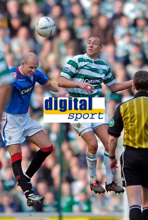 Photo. Jed Wee.,Digitalsport<br /> Glasgow Celtic v Glasgow Rangers, Scottish FA Cup, Celtic Park, Glasgow. 07/03/2004.<br /> Rangers's Henning Berg (L) contests a header with Celtic's Henrik Larsson.