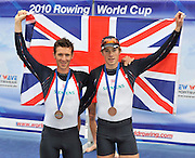 Bled, SLOVENIA,  Centre GBR LLM2-  Bronze Medalist, left, Adam FREENMAN-PASK and Chris BODDY, men's lightweight pairs, on the second day of the FISA World Cup, Bled. Held on Lake Bled.  Saturday  29/05/2010  [Mandatory Credit Peter Spurrier/ Intersport Images]