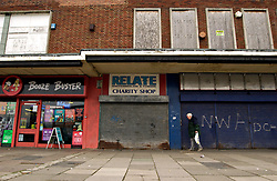 Boarded up closed shops in council estate shopping arcade; Newcastle upon Tyne UK