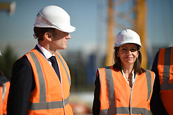 French President Emmanuel Macron, flanked by Paris Mayor Anne Hidalgo, visits the construction site of the 2024 Olympic Games Village in Saint-Ouen on the outskirts of Paris, France on October 14, 2021, part of a visit to construction sites dedicated to the Paris 2024 Olympic and Paralympic Games. Photo by Eliot Blondet/ABACAPRESS.COM