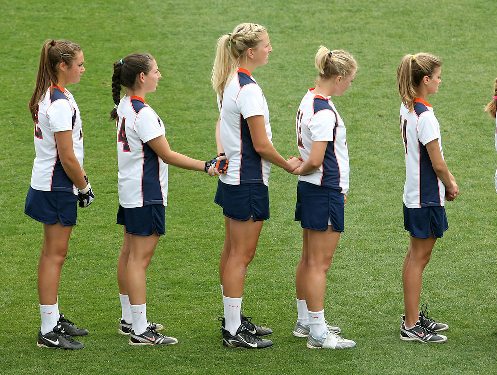 The University of Virginia women's lacrosse players hold hands during a moment of silence for former teamate Yeardley Love at the start of their first game since her death Sunday May 16, 2010 at Klockner Stadium in Charlottesville, Va. The Cavaliers rallied in the last four minutes to beat Towson 14-12 and reach the quarter finals of the NCAA tournament. Love's body was found May 3, and Virginia men's lacrosse player George Huguely is charged with murder. Photo/Andrew Shurtleff..