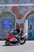 Motorcyclist on Honda CDR drives The Stelvio Pass, Passo dello Stelvio, Stilfser Joch, to Bormio, Northern Italy
