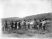 9336-AB44 nine sheep men in front of corral, one with Lugar pistol. early nitrate negative, ca. 1915?.