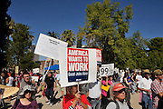 """Dominga Sierra (holding sign) protests, along with about 1,000 demonstrators who participated in Occupy Tucson at Military Plaza in Armory Park, Tucson, Arizona, USA.  The Occupy Tucson organizers created the movement in solidarity with the Occupy Wall Street movement in New York and the Occupy Together movement across the USA.  Sierra said, """"I think that I am thinking of the children and their future because everything is so hard.  There will be no jobs.  I have 18 grandchildren and I worry about every one of them.  I think that it is time to get together and fight for our rights.  I always thought what is wrong with people.  They don't get out and fight for their rights.  I think that being out of work did it.""""..The leaders of this movement are the everyday people participating in a movement with many de-centralized goals, with an over-arching theme of protesting government corruption from corporate money and national income disparity. We use a tool called the """"General Assembly"""" to facilitate open, participatory and horizontal organizing between members of the public. We welcome people from all colors, genders and beliefs to participate in our movement. .."""