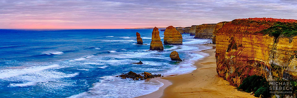 Sunrise looking west along the coastline of the Twelve Apostles, with the early sunlight casting a pink hue on the cloud on the horizon.<br /> <br /> Code: HAVS0002<br /> <br /> Limited Edition Print