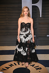 Actress Amanda Seyfried and actor Thomas Sadoski attending the 2018 Vanity Fair Oscar Party hosted by Radhika Jones at Wallis Annenberg Center for the Performing Arts on March 4, 2018 in Beverly Hills, Los angeles, CA, USA. Photo by DN Photography/ABACAPRESS.COM