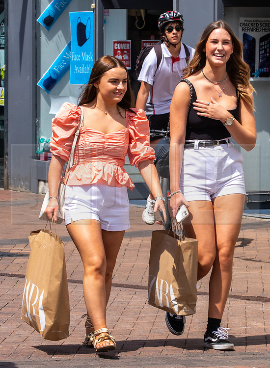 © Licensed to London News Pictures. 15/06/2020. London, UK. Young shoppers in Kingston, South West London as non essential shops are given the green light to open in England after 3 months of being closed due to the coronavirus pandemic. Also commuters are told to wear face masks from Monday while travelling on Public transport. Photo credit: Alex Lentati/LNP