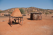 Himba tribe village, Kaokoveld, Namibia, Africa. The shed on the right is used for storage of grain or livestock