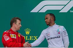 April 29, 2018 - Baku, Azerbaijan - Kimi Räikkönen and Lewis Hamilton shake hand on the podium during the award ceremony at Azerbaijan Formula 1 Grand Prix on Apr 29, 2018 in Baku, Azerbaijan. (Credit Image: © Robert Szaniszlo/NurPhoto via ZUMA Press)