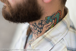 Tattooed neck at the Handbuilt Motorcycle Show. Austin, TX. April 12, 2015.  Photography ©2015 Michael Lichter.