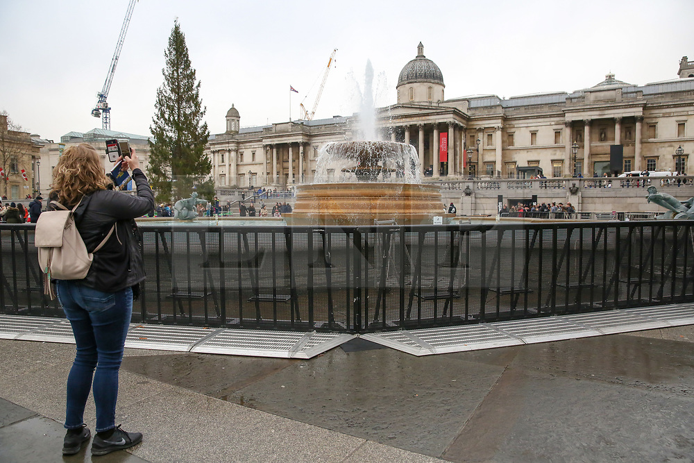© Licensed to London News Pictures. 30/12/2018. London, UK. Security fences are erected along the fountains in Trafalgar Square ahead of New Year celebrations. Photo credit: Dinendra Haria/LNP