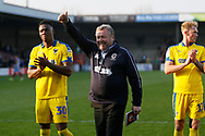 Wimbledon Manager Wally Downes applauds the fans at full time during the EFL Sky Bet League 1 match between Scunthorpe United and AFC Wimbledon at Glanford Park, Scunthorpe, England on 30 March 2019.