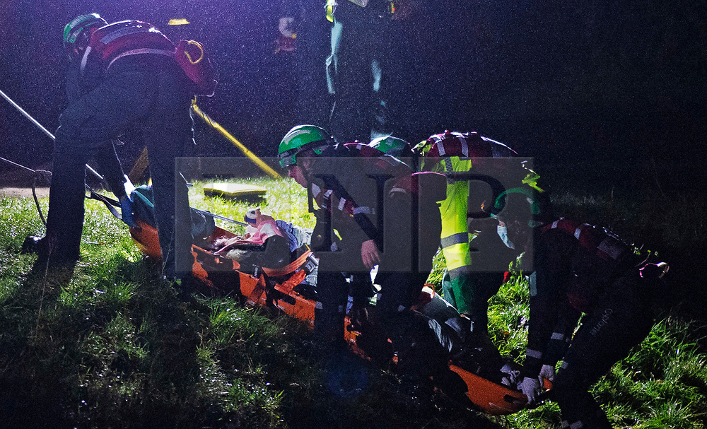 © Licensed to London News Pictures 19/01/2021.        Orpington, UK. The casualty is pulled up the river bank in a rescue stretcher. A person has been rescued from the River Cray in Orpington, South East London tonight (19.01.21) by The London Ambulance Hazardous Area Response Team along with firefighters from the London Fire Brigade.The condition of the person is unknown. Photo credit:Grant Falvey/LNP