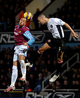 Photo: Ed Godden.<br /> West Ham United v Manchester United. The Barclays Premiership. 17/12/2006. West Ham's Bobby Zamora (L) and Rio Ferdinand compete for the ball.