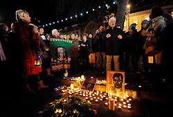 © Licensed to London News Pictures. 06/12/2013; Bristol, UK.  A candle lit vigil is held on Bristol's College Green to commemorate the life of Nelson Mandela, the first black president of South Africa who fought against apartheid and racism, and who died on 05 December 2013.  Attendees included members of ACTSA, Action for Southern Africa.  12 December 2013.<br /> Photo credit : Simon Chapman/LNP