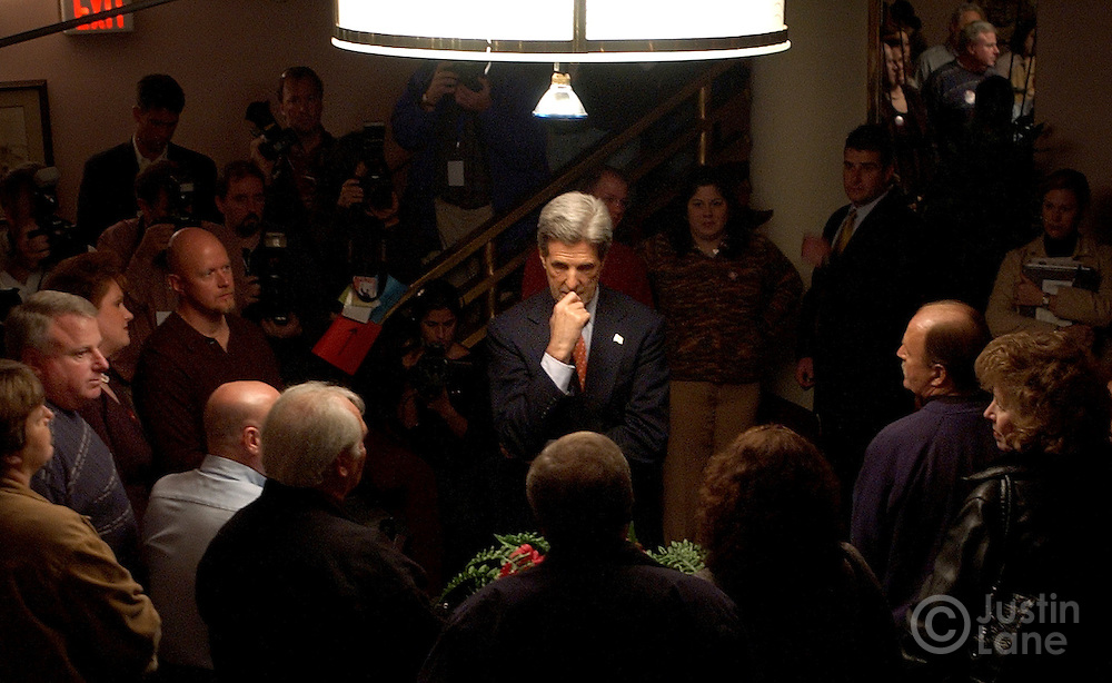 United States Senator and Democratic Candidate for President John Kerry (C) meets with workers whose jobs were outsourced to China before a speech at the F.M. Kirby Center in Wilkes-Barre, Pennsylvania Tuesday, 19 Oct, 2004. <br />EPA/JUSTIN LANE