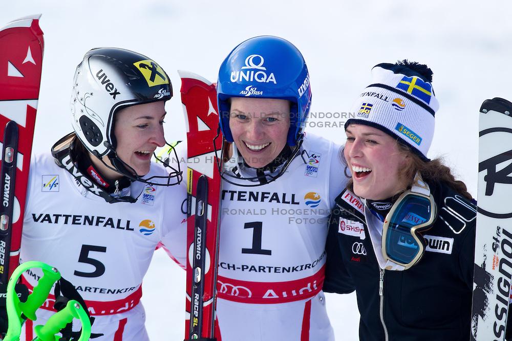 19-02-2011 SKIEN: FIS ALPINE WORLD CHAMPIONSSHIP: GARMISCH PARTENKIRCHEN<br /> Winners Presentation v.l. silver medal Kathrin Zettel (AUT), Gold Medal and World Champion Marlies Schild (AUT) and bronze Medal Maria Pietilae-Holmner (SWE) during Giant Slalom<br /> **NETHERLANDS ONLY**<br /> ©2011-WWW.FOTOHOOGENDOORN.NL/EXPA/ J. Groder