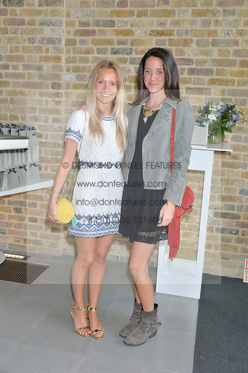 Left to right, MARTHA WARD and INDIA LANGTON at a summer drinks party hosted by Bec Astley Clarke at the Serpentine Sackler Gallery, Hyde Park, London on 17th June 2014.