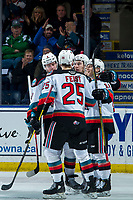 KELOWNA, BC - FEBRUARY 12: Mark Liwiski #9, Kyle Topping #24, Pavel Novak #11 and Tyson Feist #25 of the Kelowna Rockets celebrate a goal against the Tri-City Americans at Prospera Place on February 8, 2020 in Kelowna, Canada. (Photo by Marissa Baecker/Shoot the Breeze)