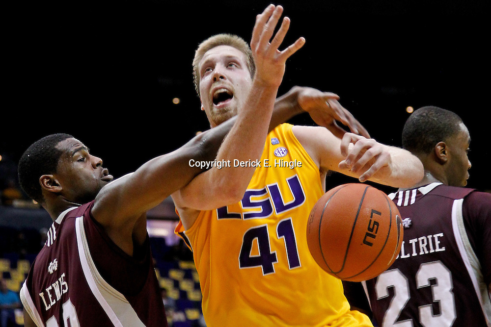 February 14, 2012; Baton Rouge, LA; Mississippi State Bulldogs forward Taylor Luczak (20) defends LSU Tigers center Justin Hamilton (41) during the first half of a game at the Pete Maravich Assembly Center.  Mandatory Credit: Derick E. Hingle-US PRESSWIRE
