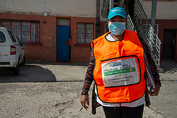 Parkwood, Cape Town, South Africa: Community health workers are doing door-to-door COVID-19 screenings in Parkwood, a suburb of Cape Town on the Cape Flats, on Thursday, April 16, 2020. The Western Cape government is ramping up mass screening and testing to stop the spread in vulnerable communities, such as low-income areas where many are living in multi-family households in crowded spaces. The aim is early detection, so that those who are testing positive can be removed to quarantine elsewhere. PHOTO: EVA-LOTTA JANSSON