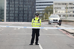 © Licensed to London News Pictures. 13/10/2020. London, UK.  Police close Westminster Bridge after armed police were seen entering St Thomas' Hospital. Photo credit: Peter Macdiarmid/LNP