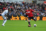 Robin Van Persie of Man Utd scores his sides 3rd goal (his 2nd). Barclays Premier league, Swansea city v Manchester Utd in Swansea, South Wales on Saturday 17th August 2013. pic by Andrew Orchard ,Andrew Orchard sports photography,