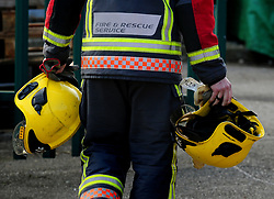 File photo dated 18/02/13 of a firefighter. Attacks on firefighters doing their job have increased by a quarter in the past year, according to their trade union.