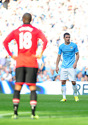 Manchester City's Aleksandar Kolarov - Photo mandatory by-line: Dougie Allward/JMP - Tel: Mobile: 07966 386802 22/09/2013 - SPORT - FOOTBALL - City of Manchester Stadium - Manchester - Manchester City V Manchester United - Barclays Premier League