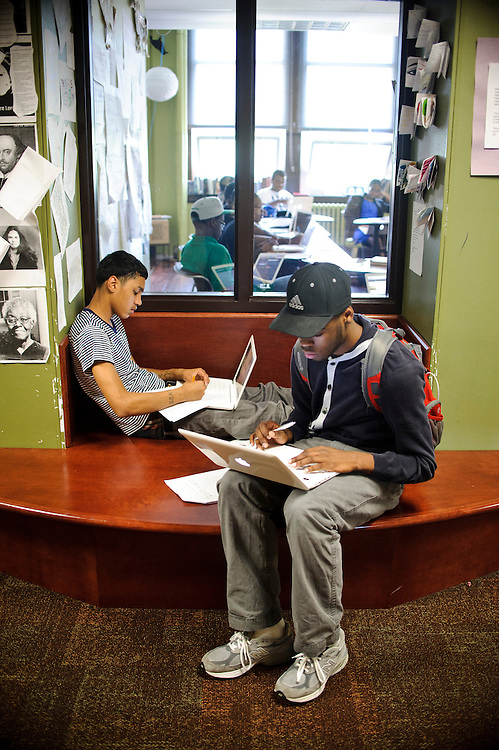 """Kintaro Campbell, foreground, and Jamel Martin, both 10h graders at City Neighbors Hamilton Charter School in Baltimore, Maryland, use a hallway nook to get some """"peace and quiet [so they can] get some stuff typed up ?have time to connect, to talk about what we're working on,"""" says Campbell. The Charter's director Bobbi Macdonald (CQ) says she wants the hallways to be extensions of the classrooms...City Neighbors Hamilton Charter School in Baltimore, Maryland, K-12, utilizes furniture purchased from hotel liquidations to create spaces for students to not only interact with other students, but space to get some quiet time to study or take a mental health moment. .. Matt Roth 