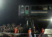 LITTLE CORNARD. SUDBURY. SUFFOLK.  Safety inspectors and Maintenance workers lift one of the two carriages above the truck involved in yesterday's level crossing train crash. Twenty one people were hurt, two seriously, when a train derailed in a crash with a lorry on a level crossing. in Little Cornard in Suffolk on 17th August. 18 August 2010. STEPHEN SIMPSON..