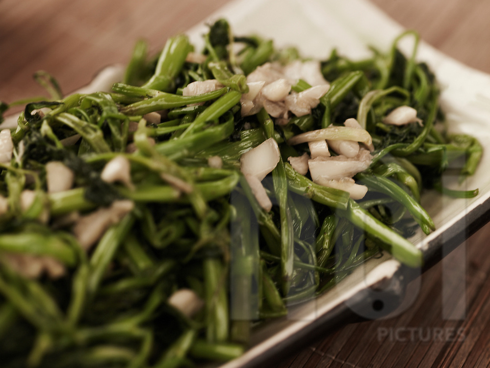 Simple but delicious morning glory sauteed with garlic, Vietnam, Southeast Asia