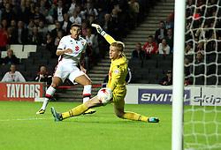 Daniel Powell of Milton Keynes Dons scores past Ben Amos of Bolton Wanderers - Mandatory byline: Robbie Stephenson/JMP - 07966386802 - 18/08/2015 - FOOTBALL - Stadium MK -Milton Keynes,England - MK Dons v Bolton Wanderers - Sky Bet Championship
