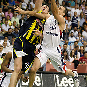 Efes Pilsen's Igor RAKOCEVIC (R) and Fenerbahce Ulker's Emir PRELDZIC (L) during their Turkish Basketball league Play Off Final fifth leg match Efes Pilsen between Fenerbahce Ulker at the Ayhan Sahenk Arena in Istanbul Turkey on Sunday 30 May 2010. Photo by Aykut AKICI/TURKPIX