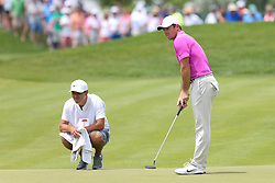 June 22, 2018 - Cromwell, Connecticut, United States - Rory McIlroy (R) and his caddie on the 9th green during the second round of the Travelers Championship at TPC River Highlands. (Credit Image: © Debby Wong via ZUMA Wire)